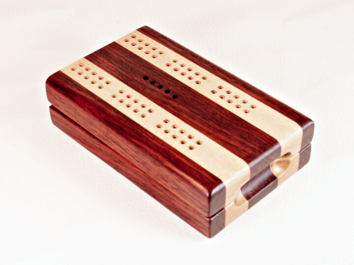 A Bubinga and Maple Travel Cribbage Board closed up and ready for travels.